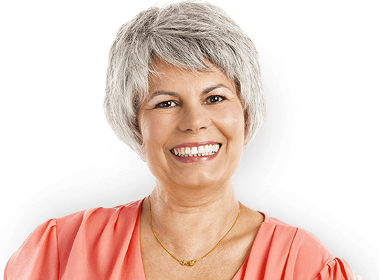 Woman with short gray hair smiling with beautiful dental implants.