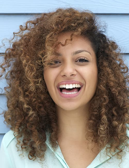 A young woman with a huge smile