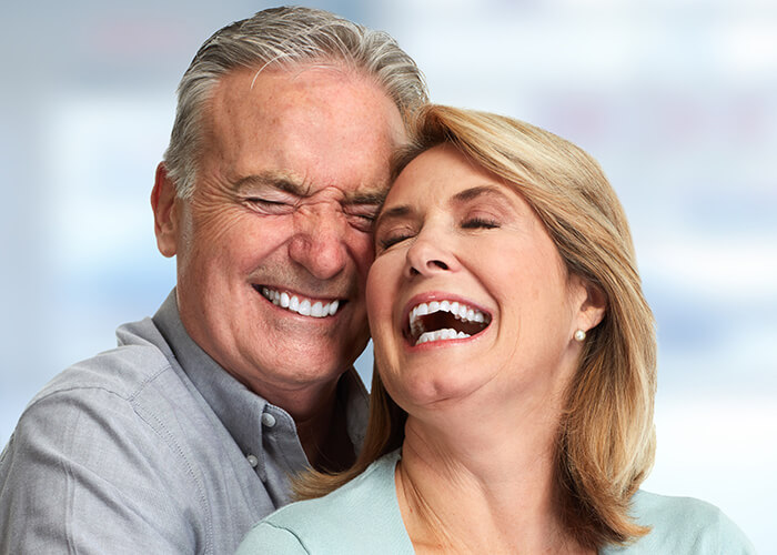 A couple laughing together at West Chester Dental Arts