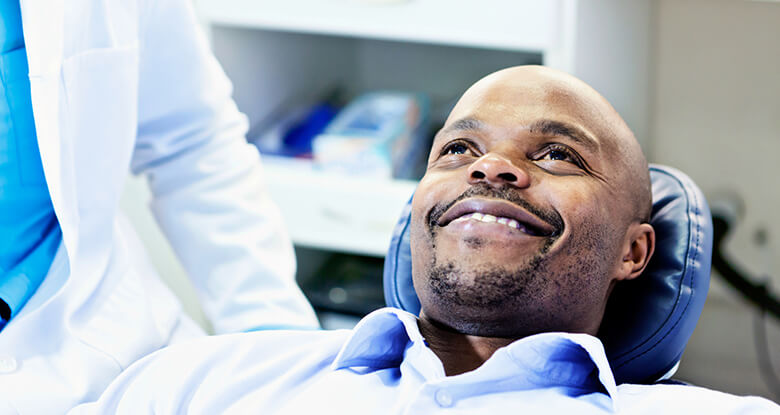Man smiling on dentist chair
