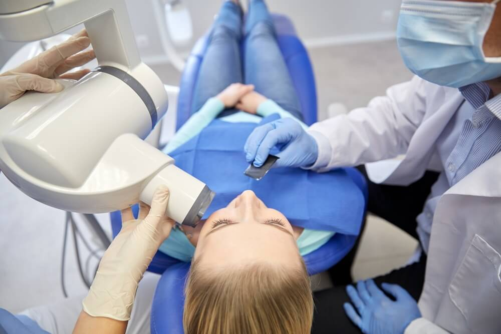 Woman having a dental x ray taken
